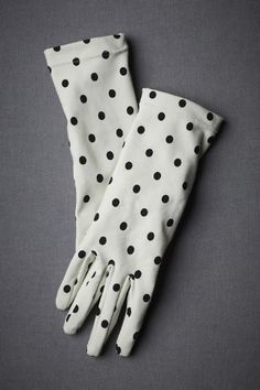 Black and polka vintage gloves. All I can think of is 101 dalmatians but I still love these!