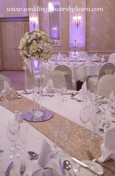 These Vera Wang Inspired balls of roses look stunning on tall lily vases, and look beautiful alternated with candleabras with crystals by Blue leaf Event Hire.@blueleafeventhire   stunning  classic simple look. ( Rowton Hall Hotel) @rowtonhallhotel www.weddingflowersbylaura .com