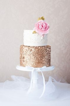 Gorgeous white lace cake with gold detail and pink sugar peony