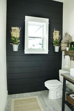 Black Shiplap Bathroom: An edgier take on the trend black shiplap is a great way to combine contemporary and classic. Check out these stunning interiors that embraced shiplap's bolder moodier side. Bathroom Decor; Bathroom Ideas; Bathroom Remodel; Bathroom Modern; Bathroom Organization; Bathroom Master; Bathroom Small; Bathroom Storage; Bathroom Colors; Bathroom Design; Farmhouse style bathroom; Separate showers; Wood shelves; floating shelves