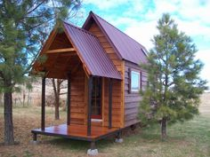 Houses Built On Trailers | tall tiny house with a porch 600x450 Tall Tiny House with a Porch and ...