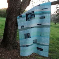 Hey, I found this really awesome Etsy listing at http://www.etsy.com/listing/129880658/blue-quilt-modern-quilt-ocean-waves-art