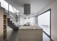 Patio House is a minimalist home located in Loriguilla, Spain, designed by Alberto Facundo Arquitectura. The project consists of two volumes that respond to the surrounding typology. The space between the two volumes serves as an open living space focused around lighting, circulation, and organization. The staircase is also a central element, separating open on both sides and constructed of concrete. With the initial premise of providing privacy to the house, direct views to the outside are…