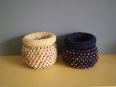 These little pots fit in the palm of your hand but are sturdy enough to stand up on their own. You will only need about 15g of double knitting weight yarn to knit a Dotty Pot and a much smaller amount of variegated yarn for the dots. They are knitted in the round and are fun to knit - much easier than they look. Instructions are also included for a bigger pot.