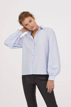 Light blue. Straight-cut shirt in an airy cotton and viscose blend. Collar, buttons at front, and long balloon sleeves with buttons at cuffs.