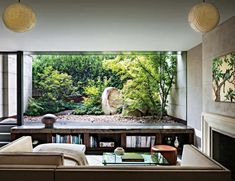 """This room was treated like a glass box,"" says Rees Roberts of the immaculate Zen viewing garden. A solid slab of stone, imported from Japan, is intersected by the window. ""Each one of these plants was placed thoughtfully, like a flower arrangement."""