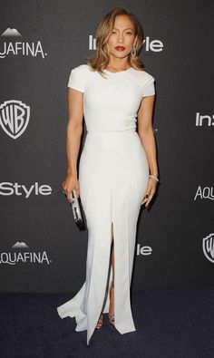 2016 Golden Globes: Jennifer Lopez is wearing a white Roland Mouret short sleeve dress with a front slit. Again J.Lo is beautiful! A vision in white! I love the dark lip and the silver embellished box clutch for a pop of bling!