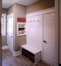 neutral laundry colors -   traditional laundry room by Weaver Custom Homes