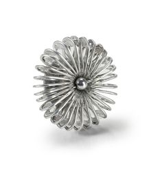 Contemporary brooch with unique pinwheel design. Modern jewelry intricately crafted by fair trade artisans from recycled aluminum soda tabs. Comes with metal backing and locking straight pin closure.