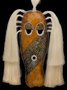 Ann Light is an award-winning gourd artist who specializes in creating ethnic masks out of gourds. Highly collectible, each mask is a signed original. Ceramic Mask, Textile Fiber Art, Masks Art, Tiny Dolls, Gourd Art, Artist Gallery, Women In History, Headgear, Gourds