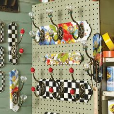 Pattern and color abounds...adore this site! Coat racks from MacKenzie-Childs.com