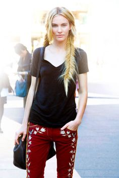Burgundy pants and some fishtail braids for your pleasure. From elle.com