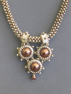 Beaded necklace. Make a pattern with the star/sun-like beaded beads.