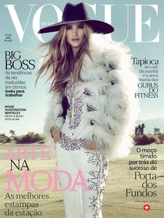 Rosie Huntington-Whiteley graces the April 2013 cover of Vogue Brazil. Lensed by Henrique Gendre. Love the Saint Laurent hat.