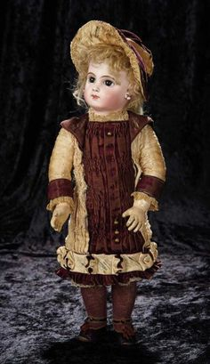 "19""~French Bisque Bebe E.J., Size 8, by Emile Jumeau in Original Couturier Costume~~Marks: Depose E. 8 J. (head) Jumeau Medaille d'Or Paris. (body). Comments: Emile Jumeau, circa 1882. Value Points: beautiful wide-eyed bebe has fine luminous bisque, richly-painted features, original wig, body, body finish, and wearing fine (albeit frail) original costume."