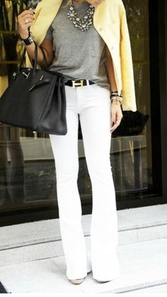 white boot cut jeans paired with black leather belt, grey shirt, statement necklace and bright blazer