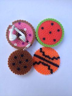 Earbud holder perler bead watermelon donut by infiniteyouthjewelry 3d Perler Bead, Pearler Beads, Fuse Beads, Hama Beads Design, Hama Beads Patterns, Beading Patterns, Diy Earbud Holder Perler Beads, Pixel Beads, 8bit Art