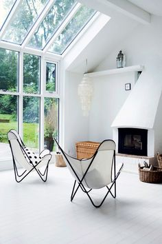 Black and white summer cottage living room via Coco Lapine Design blog.