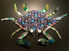 This colorful blue crab is a unique one of a kind. It will make a wonderful gift or conversation piece. It is made from various colored beer caps