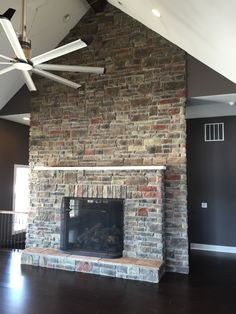 Gorgeous Ceiling high Stoned Fireplace with Hearth and mantle. Dakota Cut Cobble and Laytite Blend. J&N Stone
