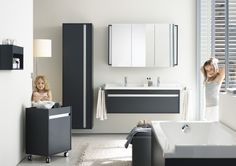 Duravit Ketho series. Featuring a wall mounted vanity with a one large drawer, wall mounted mirrored cabinet, wall mounted tall linen tower, and a mobile storage unit.