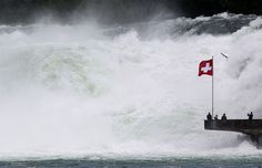 Visitors stand on a platform beside the Rhine Falls in the town of Neuhausen south of Schaffhausen June 13, 2012. The Rhine Falls are the largest falls in Europe, with an average flow of 700 cubic metres per second (25,000 cubic ft/sec) the water cascades down the cataracts, which are 150 metres (450 ft) wide and 23 metres (75 ft) high.