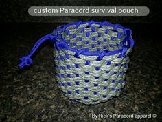 Custom made Paracord pouch good for carrying stuff and a good source of cord about 50' of cord used. 25' of each color