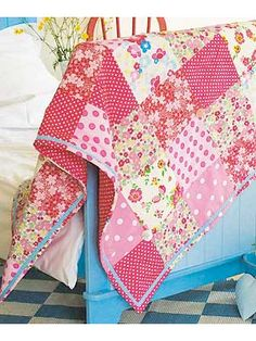 Sew a patchwork quilt bedspread - 8 hours from beginning to end.  Love the buttons and ribbon embellishments.