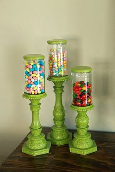 Just find 3 candlesticks. primed them and then spray painted them green. The jars were old Fry's salsa jars soaked in bleach solution and labels peeled off. The lids were spray painted to match the candlesticks. We glued the jars onto the candlesticks with gorilla glue. Easy peasy.