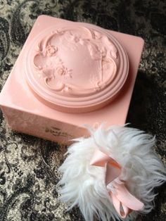Just one glimpse of this lovely Art Deco powder box and puff takes me back to my girl-hood. White Shoulders was the name of the classic scent of it's day. My mother wore it, and it was the first scent I ever put on ushering me into the potential for loveliness in all that is Woman.