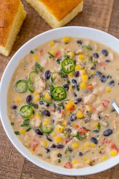 Creamy Chicken Poblano Pepper Soup made with red bell peppers, corn, black beans, roasted poblano peppers and lime finished off with a bit of cream.