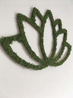 FREE SHIPPING WORLDWIDE   Unique laser cut LOTUS FLOWER wall sign with wooden base and decorated with green Scandinavian lichens.  Lichens have been preserved using non-toxic processes that make them last many years without any maintenance. No water, sun or humidity is necessary, the only care is to keep them away from direct sunlight.  Particularly good in yoga studios, relaxation rooms, spas, home offices, bedrooms, living rooms.   Measures: 28 x 17 cm Lotus Flower, Flower Wall, Yoga Studios, Relaxation Room, Spas, Wall Signs, Laser Cutting, Offices, Sunlight
