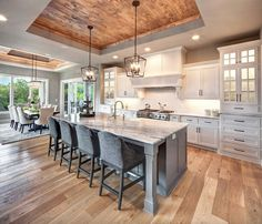 Gray kitchens have a timeless sophistication suitable for various design styles to create a chic aesthetic for cooking and entertaining. Wood Floor Kitchen, Wooden Kitchen, New Kitchen, Kitchen Ideas, Kitchen Layout, Kitchen Inspiration, Aqua Kitchen, Rooster Kitchen, Turquoise Kitchen
