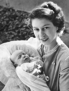 (then) Princess Elizabeth holding her daughter, Princess Anne