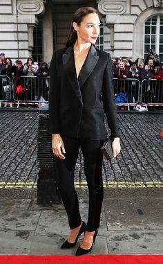 Gal Gadot from The Best of the Red Carpet  Our new favorite superhero brings some Hollywood glam to rainy London in a sophisticated tailored tux.