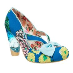 Hello Ha! This bright style features a blue-tinted lucite heel, and a blue toe-box bow. The unique cut-out upper with a flower print makes this heel perfect for sunny days!