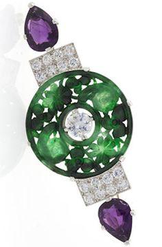 *An Art Deco platinum brooch with diamonds, amethysts, and nephrite jade. (Via www.macklowegallery.com)