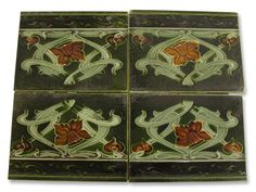 Antique Art Nouveau ceramic tiles dark green with daffodils Antique Art Nouveau ceramic tiles dark green with daffodilsDescription This has pretty detail flowers and hearts. Set of four. Some wear. They date circa 1900.   Dimensions 6 in. L x 4.5 in. W. $200