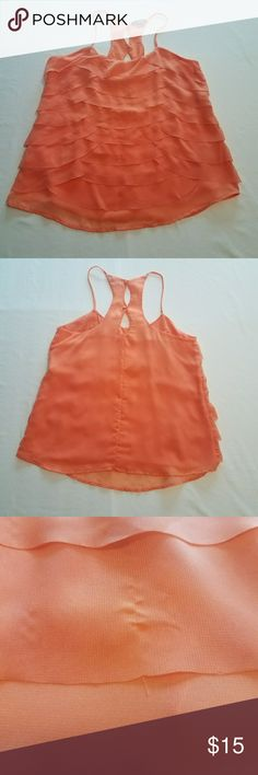 Ruffle Tank Tangerine chiffon ruffle tank with spaghetti traps. Button up back.   Please note there is a very tiny snag on the front towards the bottom. (See picture)  Size medium. 100% polyester My Michelle Tops Tank Tops