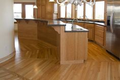 """We recently installed a round floor plan kitchen. This design presented the perfect oppurtunity to install a custom """"sunburst"""" or """"wagon wheel"""" red oak hardwood floor. Each spline has a tongue on..."""