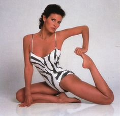 Raquel Welch getting her yoga on! In 1987. Loved and Pinned by www.downdogboutique.com to our Yoga community boards
