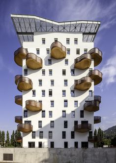 r2k Architects have designed a residential building in Grenoble, France, that features a variety of organically shaped balconies.