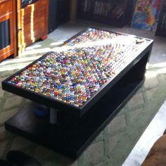 My bottle cap coffee table creation