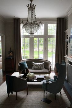 sitting room... love the extra square of window up top.. and with a fireplace on one side and wall to ceiling bookshelves on the other side... with a desk in the middle