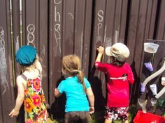 fence art (happyhooligans)  What? Paint a section of back yard fence with chalk board paint?  I LOVE it!!!