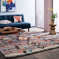Tradition with a twist. Hand tufted by artisans in India, our long-pile Charm Wool Rug features a traditional Moroccan pattern updated in a fresh palette. Perfect as a focal piece for the floor, it also looks stunning hung on a wall.