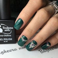 This shade of green is very popular in cold autumn days. I wold wear it with some dress in similar color on some important day. Rhinestones makes and here manicure luxury.