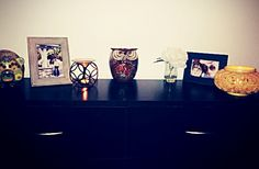 Candles, vase, pictures, piggy bank