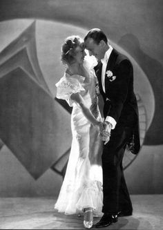 Fred Astaire and Ginger Rogers.  They always appear to be truly enjoying themselves and each other.  It doesn't seem forced for the camera. I love the lighting in this.