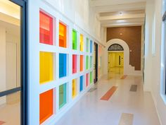 Cheerful colors of Glass create an upbeat transition in this community center hallway.